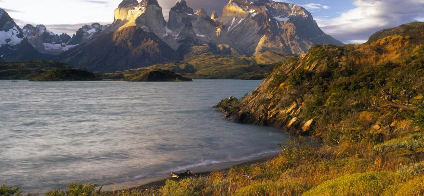 Chile, Patagonia, Torres del Paine NP, Lenticular clouds at sunset over the Cuernos del Paine from the shore of Lago Pehoe